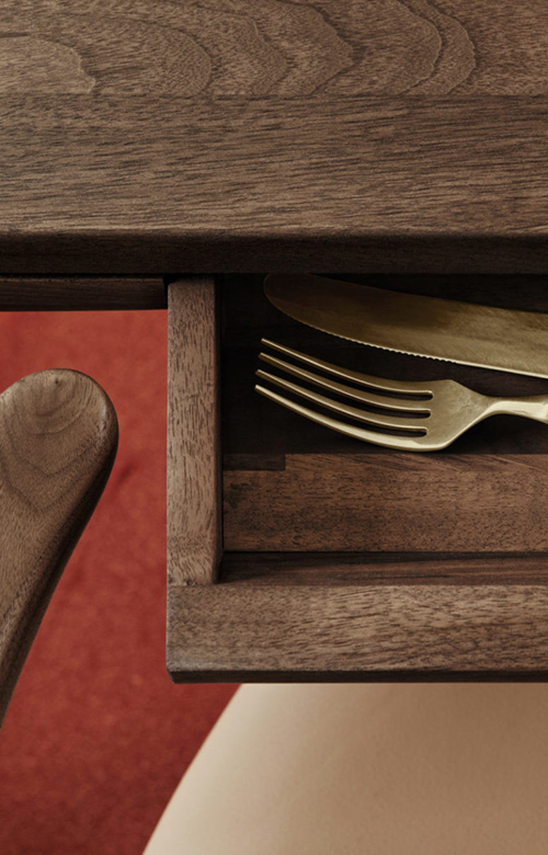02-Theres-a-small-drawer-concealed-in-the-table-it-may-be-used-for-storing-cutlery-775x1163