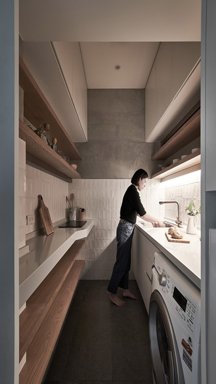 03-The-kitchen-accomodates-some-appliances-and-features-much-storage-plus-countertops-to-use-for-cooking-and-eating