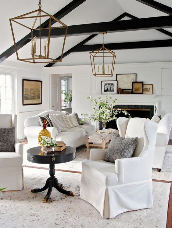 03-a-fresh-take-on-a-farmhouse-interior-with-two-white-sofas-and-black-wooden-beams-for-a-contrast