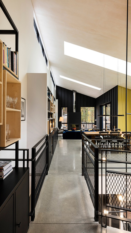 04-The-overall-decor-continues-this-idea-theres-concrete-black-painted-wood-and-much-blackened-metal