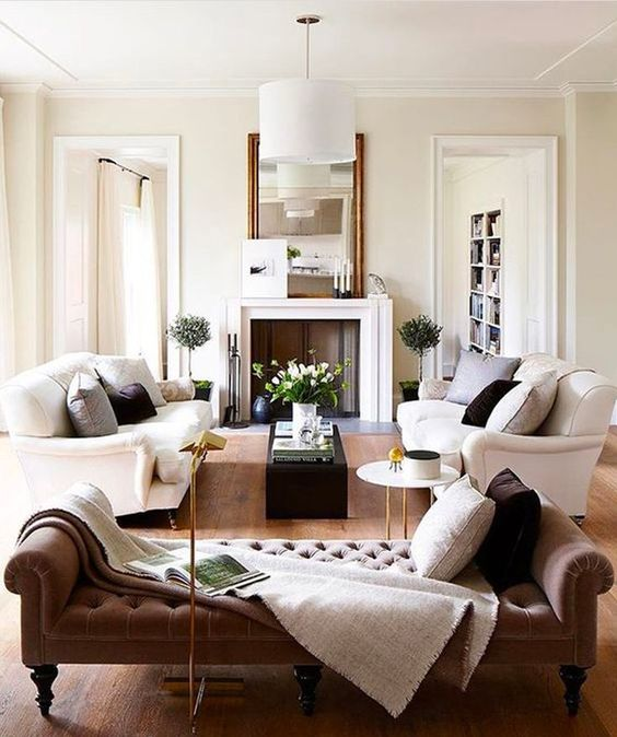 05-a-refined-living-room-with-two-white-sofas-and-a-tufted-daybed-for-a-luxurious-feel