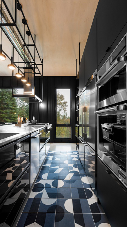 06-A-moody-kitchen-is-done-with-black-sleek-cabinets-a-mosaic-tile-floor-in-black-and-white