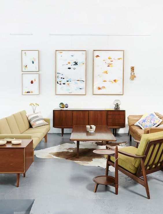 06-a-bright-mid-century-modern-living-room-with-mustard-colored-furniture-and-abstract-paintings