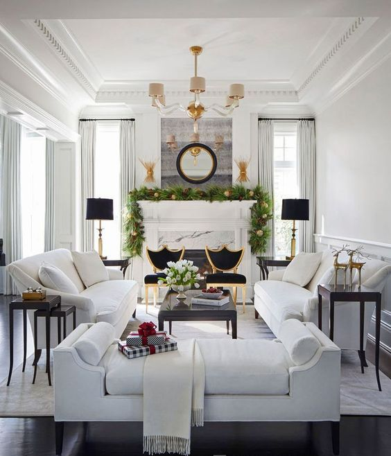 06-a-gorgeous-living-room-with-a-luxurious-feel-two-white-sofas-contrast-two-black-chairs-next-to-them