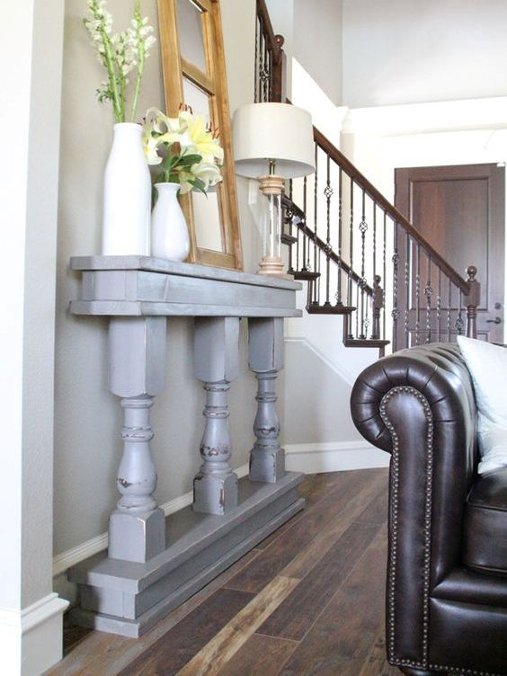 06-a-grey-vintage-console-of-a-table-cut-in-halves-is-a-great-fit-for-this-vintage-space