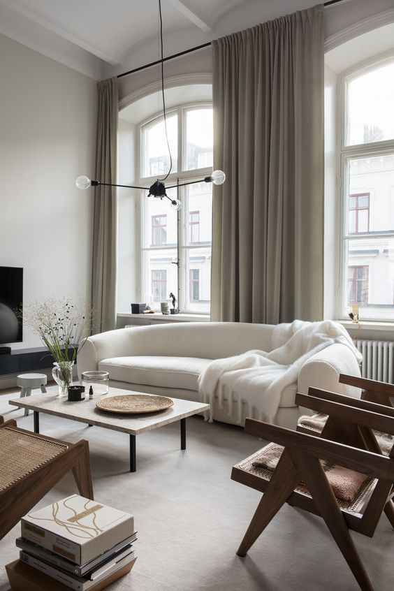 15-an-elegant-contemporary-living-room-with-a-rounded-white-sofa-that-is-a-centerpiece-here