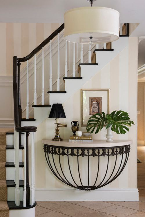 17-a-refined-console-table-with-a-stone-top-and-forged-detailing-is-ideal-for-a-refined-art-deco-entryway