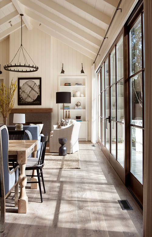 17-custom-stained-oak-hardwood-flooring-and-white-washed-exposed-beams-create-a-rustic-ambiance