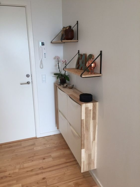 23-a-very-narrow-floating-console-of-an-IKEA-shoe-cabinet-with-a-plywood-waterfall-tabletop-for-a-tiny-entryway